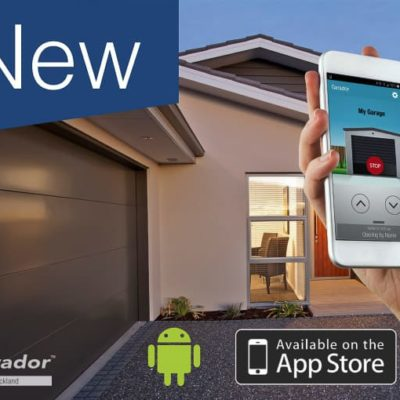 Hand holding mobile phone with garage app opened